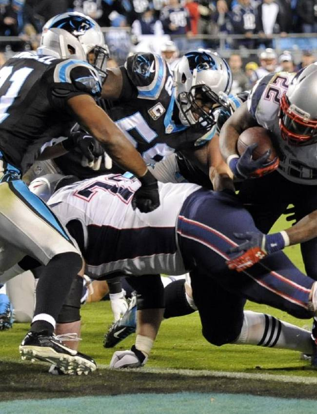 New England Patriots' Stevan Ridley (22) runs for a tocuhdown as Carolina Panthers' Mike Mitchell (21) defends during the second half of an NFL football game in Charlotte, N.C., Monday, Nov. 18, 2013