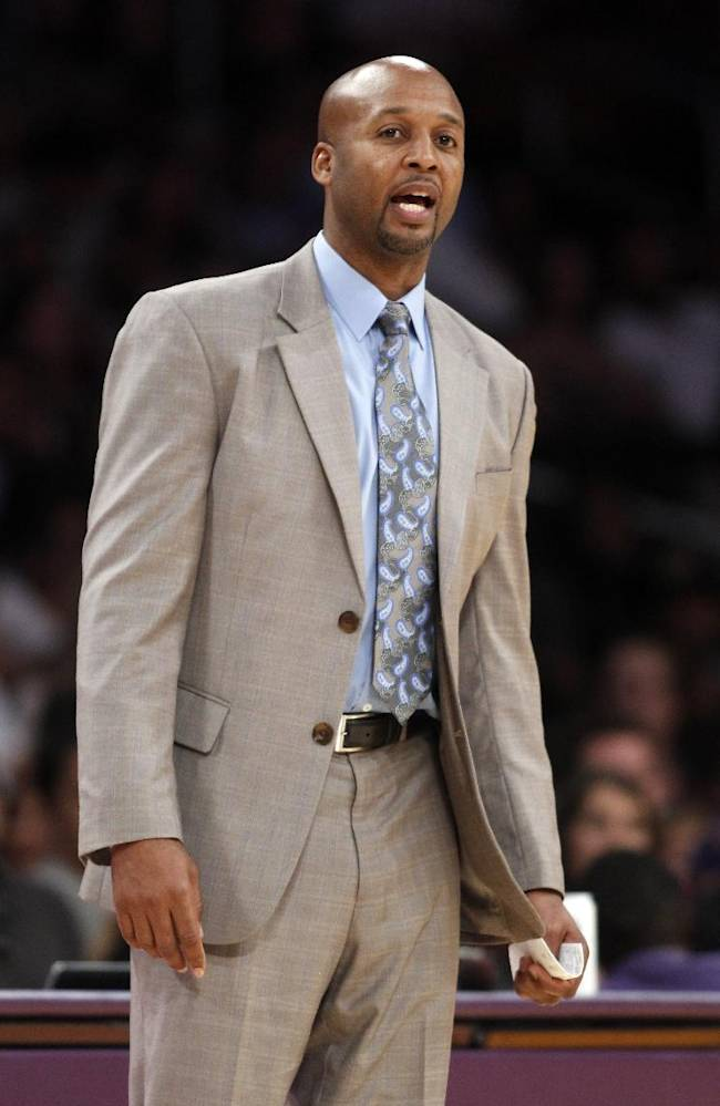 Denver Nuggets head coach Brian Shaw on the sidelines in the fourth quarter of an NBA preseason basketball game against the Los Angeles Lakers Sunday, Oct. 6, 2013 in Los Angeles. The Nuggets won 97-88