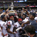 In this Jan. 3, 2014 file photo, Oklahoma holds up the Sugar Bowl trophy after defeating Alabama 45-31 in the NCAA college football matchup in New Orleans. It now seems like forever since Oklahoma defeated Alabama in the Sugar Bowl. The hype around the pr