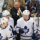 Toronto Maple Leafs head caoch Randy Carlyle, back, directs his players, from front left, Leo Komarov, Mike Santorelli, Peter Holland and Sam Carrick against the Colorado Avalanche in the second period of an NHL hockey game in Denver, Thursday, Nov. 6, 20