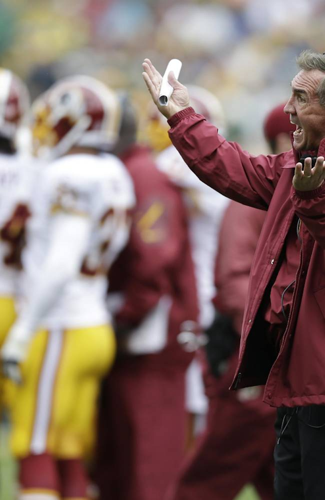Washington Redskins head coach Mike Shanahan argues a call during the first half of an NFL football game against the Green Bay Packers Sunday, Sept. 15, 2013, in Green Bay, Wis