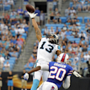 Carolina Panthers' Kelvin Benjamin (13) reaches in vain for a pass as Buffalo Bills' Corey Graham (20) defends during the first half of a preseason NFL football game in Charlotte, N.C., Friday, Aug. 8, 2014 The Associated Press