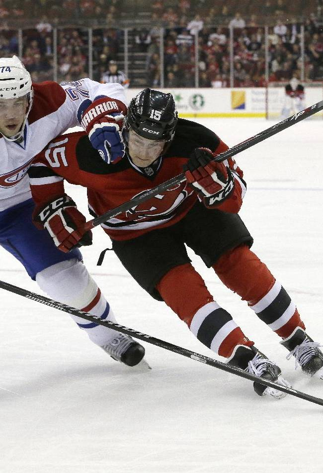 New Jersey Devils left wing Reid Boucher, right, skates against Montreal Canadiens defenseman Alexei Emelin, of Russia, during Boucher's NHL hockey debut game during the second period of an NHL hockey game, Wednesday, Dec. 4, 2013, in Newark, N.J