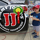 Two-year-old Keelan Harvick, son of driver Kevin Harvick, wipes down the car before practice for the Irwin Tools Night Race NASCAR Sprint Cup Series auto race at Bristol Motor Speedway on Friday, Aug. 22, 2014, in Bristol, Tenn. (AP Photo/Wade Payne)