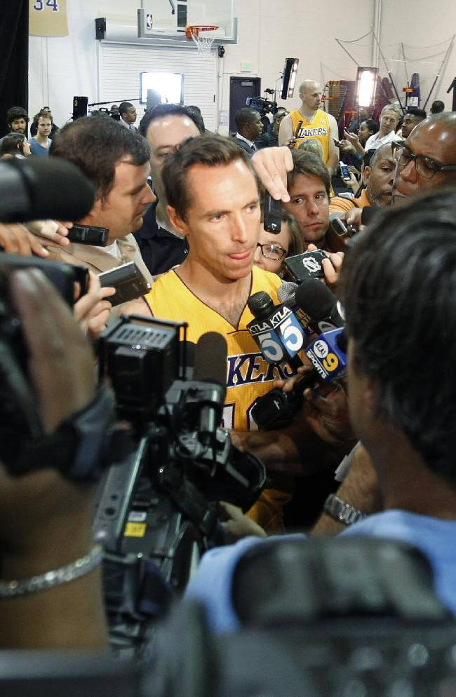 Los Angeles Lakers guard Steve Nash, center, talks to reporters during the NBA basketball team's media day Saturday, Sept. 28, 2013, in El Segundo, Calif