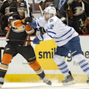 The Ducks' Rene Bourque, left, is being body checked by the Maple Leafs' Stephane Robidas during a game at Honda Center on Wednesday Jan. 14, 2015 The Associated Press