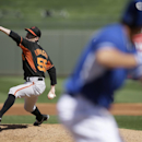 San Francisco Giants' Tim Lincecum pitches to the Kansas City Royals in the second inning of a spring training baseball game, Friday, March 7, 2014, in Surprise, Ariz The Associated Press