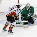 Anaheim Ducks center Nate Thompson (44) and Dallas Stars goalie Kari Lehtonen (32), of FInland, watch the game winning goal during the overtime period of an NHL hockey game Friday, Oct. 31, 2014, in Dallas The Associated Press