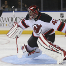New Jersey Devils goalie Scott Clemmensen (40) makes a save during the second period of their preseason NHL hockey game against the New York Rangers, Monday, Sept. 22, 2014, in New York The Associated Press