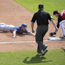 New York Mets Eric Campbell, left, is tagged out by Atlanta Braves third baseman Phil Gosselin (11) after trying to stretch a double into a triple during the fifth inning of a spring training baseball game Wednesday, March 4, 2015, in Kissimmee, Fla. Watching is Mets third base coach Tim Teufel (18) and third base umpire Andy Fletcher.(AP Photo/Phelan M. Ebenhack)