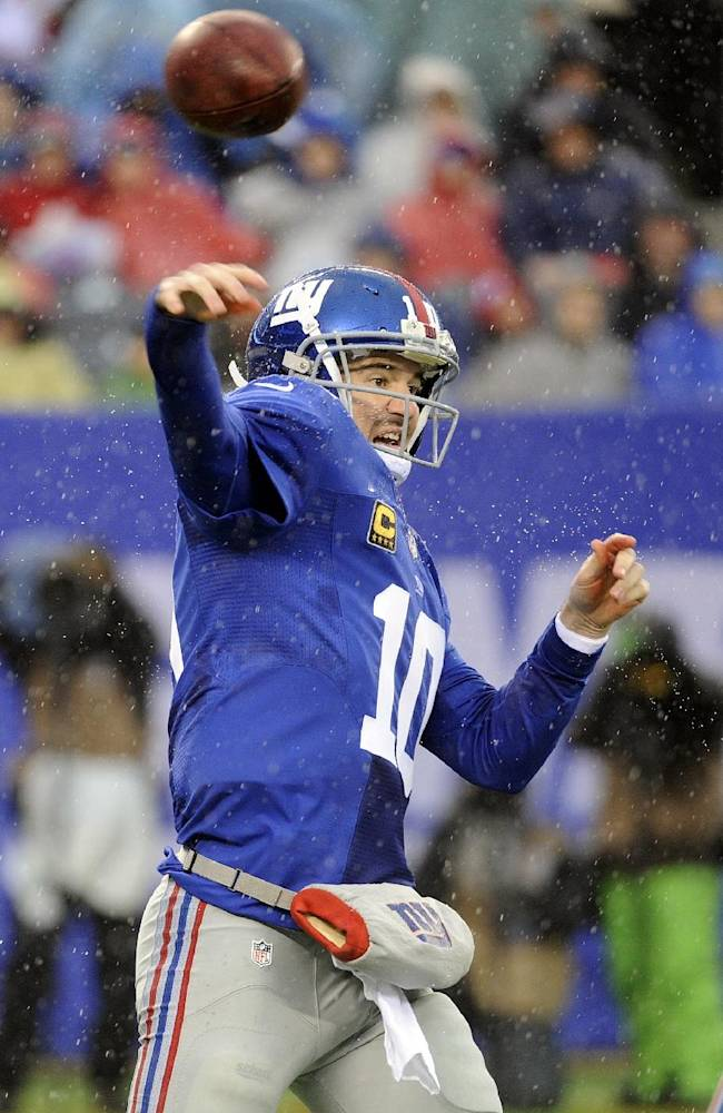 Manning hurt late in first half of Giants-Redskins