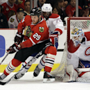 Chicago Blackhawks' Bryan Bickell (29) controls the puck against Montreal Canadiens' P.K. Subban (76) as goalie Peter Budaj (30) looks on during the second period of an NHL hockey game in Chicago, Wednesday, April 9, 2014 The Associated Press