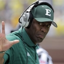 FILE - In this Sept. 17, 2011, file photo, Eastern Michigan coach Ron English gestures on the sidelines during the first quarter of an NCAA college football game against Michigan in Ann Arbor, Mich. Eastern Michigan Eagles need new bathrooms, and coach English is ready to jump out of a plane to get them. English has pledged to skydive if EMU can raise at least $60,000 through its golf outing June 8 and other donations. (AP Photo/Carlos Osorio, File)
