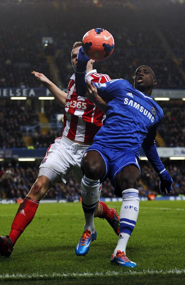 Chelsea's Demba Ba, right fights for the ball with Stoke City's captain Ryan Shawcross, left, during an English FA Cup 4th round soccer match at the Stamford Bridge ground in London, Sunday, Jan. 26, 2014. Chelsea won the match 1-0