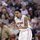 Florida's Mike Rosario encourages his teammates after making a three-point basket against Minnesota during the second half of a third-round game of the NCAA college basketball tournament Sunday, March 24, 2013, in Austin, Texas. Florida beat Minnesota 78-64. (AP Photo/David J. Phillip)