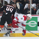 The Ducks' Nate Thompson checks the Hurricanes' Jay McClement during the second period of their hockey game at Honda Center Tuesday night Feb. 3, 2015 The Associated Press