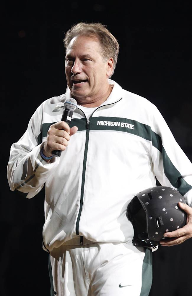 Michigan State coach Tom Izzo addresses fans before an NCAA college basketball scrimmage, Friday, Oct. 18, 2013, in East Lansing, Mich