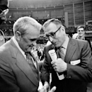 FILE - In this March 27, 1971, file photo, Villanova University basketball coach Jack Kraft, left, congratulates UCLA coach John Wooden after Wooden's Bruins defeated Villanova, 68-62, to win the NCAA championship in Houston, Texas. Villanova officials say former head basketball coach John