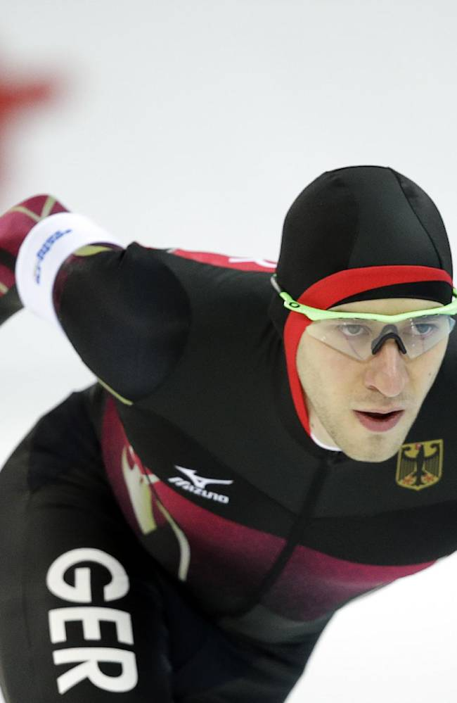 Alexej Baumgaertner of Germany, front, and Norway's Simen Spieler Nilsen, rear left, compete in the men's 5,000-meter speedskating race at the Adler Arena Skating Center during the 2014 Winter Olympics, Saturday, Feb. 8, 2014, in Sochi, Russia