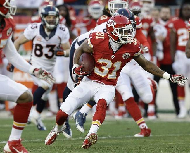 Kansas City Chiefs cornerback Marcus Cooper (31) runs after intercepting a pass during the first half of an NFL football game against the Denver Broncos, Sunday, Dec. 1, 2013, in Kansas City, Mo