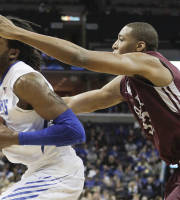 Memphis forward Shaq Goodwin, left, goes to the basket against Arkansas-Little Rock forward James White (33) in the second half of an NCAA college basketball game on Friday, Dec. 13, 2013, in Memphis, Tenn. Memphis won 73-59.. (AP Photo/Lance Murphey)