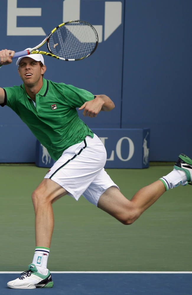 Sam Querrey, of the United States, returns a shot against Maximo Gonzalez, of Argentina, during the first round of the 2014 U.S. Open tennis tournament, Tuesday, Aug. 26, 2014, in New York