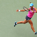 Varvara Lepchenko, of the United States, returns a shot against Serena Williams, of the United States, during the third round of the 2014 U.S. Open tennis tournament, Saturday, Aug. 30, 2014, in New York. (AP Photo/Matt Rourke)