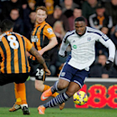 West Bromwich Albion's Victor Anichebe, right, and Hull City's Tom Huddlestone in action during the English Premier League soccer match at the KC Stadium, Hull, England, Saturday Dec. 6, 2014