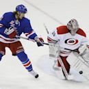 Carolina Hurricanes goalie Cam Ward (30) stops a shot by New York Rangers' Carl Hagelin (62) during the third period of an NHL hockey game Tuesday, April 8, 2014, in New York. The Rangers won 4-1 The Associated Press