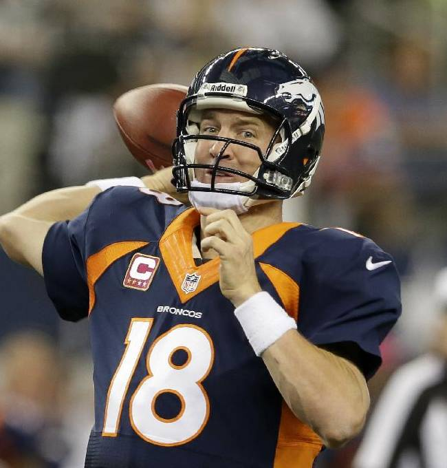 Denver Broncos quarterback Peyton Manning (18) passes with under two minutes to go during the fourth quarter of an NFL football game against the Dallas Cowboys Sunday, Oct. 6,2013, in Arlington, Texas. The Broncos won 51-48
