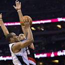 Orlando Magic's Arron Afflalo, left drives by Portland Trail Blazers' Nicolas Batum (88) during the first half of an NBA basketball game in Orlando, Fla., Tuesday, March 25, 2014 The Associated Press