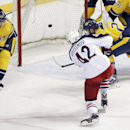 Columbus Blue Jackets center Artem Anisimov (42), of Russia, scores between Nashville Predators' Anton Volchenkov (20), of Russia, and Paul Gaustad (28) in the first period of a preseason NHL hockey game Monday, Sept. 29, 2014, in Nashville, Tenn The Asso