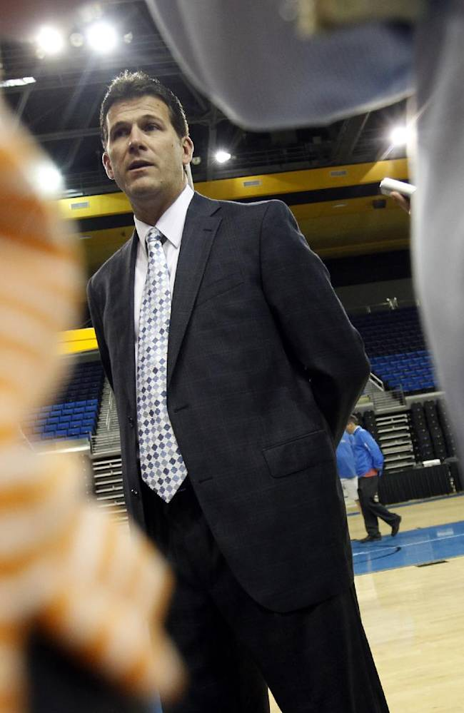 UCLA head coach Steve Alford answers questions during the NCAA college basketball team's media day, Monday, Oct. 14, 2013, in Los Angeles