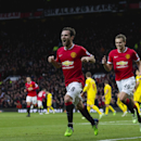 Manchester United's Juan Mata celebrates after scoring during the English Premier League soccer match between Manchester United and Liverpool at Old Trafford Stadium, Manchester, England, Sunday, Dec. 14, 2014