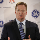 NFL Commissioner Roger Goodell talks with reporters in New York, Monday, March 11, 2013. GE is partnering with the NFL, the US Military, and others to further research on head injuries. (AP Photo/Seth Wenig)