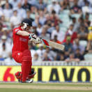 England's Eoin Morgan hits a four off the bowling of South Africa's Chris Morris during their ICC Champions Trophy semifinal cricket match at the Oval cricket ground in London, Wednesday, June 19, 2013. (AP Photo/Sang Tan)