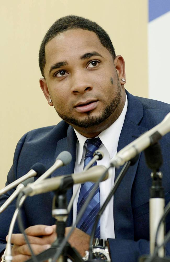 Yakult Swallows slugger Wladimir Balentien speaks during a press conference in Tokyo Wednesday, Jan. 29, 2014. Balentien has apologized to his fans, several days after pleading not guilty to domestic violence charges in Florida. As is the custom in Japan, Balentien bowed deeply and then apologized Wednesday to his fans and teammates for the actions that led to his arrest on Jan. 13