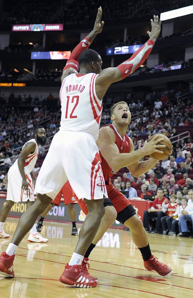 Houston Rockets' Dwight Howard (12) hovers over Los Angeles Clippers' Blake Griffin in the first half of an NBA basketball game on Saturday, Nov. 9, 2013, in Houston