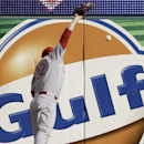 Cincinnati Reds right fielder Jay Bruce cannot reach a two-run double by St. Louis Cardinals' Matt Holliday during the sixth inning of a baseball game Tuesday, April 8, 2014, in St. Louis The Associated Press