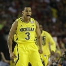 Michigan guard Trey Burke (3) reacts to play against the Louisville during the first half of the NCAA Final Four tournament college basketball championship game Monday, April 8, 2013, in Atlanta. (AP Photo/David J. Phillip)
