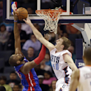 Detroit Pistons' Greg Monroe, left, gets his shot blocked by Charlotte Bobcats' Cody Zeller during the first half of an NBA basketball game in Charlotte, N.C., Wednesday, Feb. 19, 2014 The Associated Press