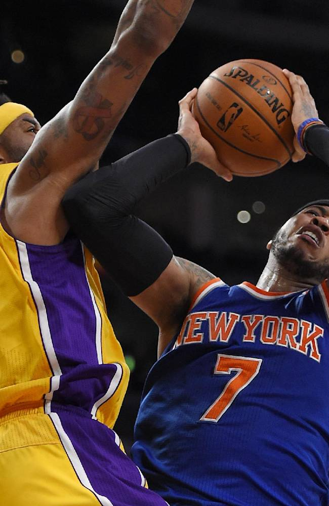 New York Knicks forward Carmelo Anthony, right, puts up a shot as Los Angeles Lakers forward Jordan Hill defends during the second half of an NBA basketball game, Tuesday, March 25, 2014, in Los Angeles. The Lakers won 127-96