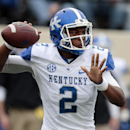 Kentucky quarterback Jalen Whitlow passes against Vanderbilt in the second quarter of an NCAA college football game on Saturday, Nov. 16, 2013, in Nashville, Tenn The Associated Press