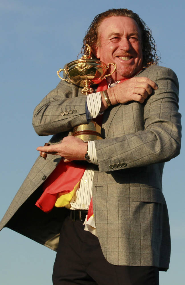 This is a Monday, Oct.  4, 2010  file photo of Europe's Miguel Angel Jimenez as he holds the trophy after Europe won the 2010 Ryder Cup golf tournament at the Celtic Manor Resort in Newport, Wales. Europe will be taking five vice captains to the Ryder Cup at Gleneagles, with Miguel Angel Jimene,  Padraig Harrington, and Jose Maria Olazabal added to the list of Paul McGinley's assistants on Wednesday  Sept. 3, 2014. McGinley had named Sam Torrance and Des Smyth as his first two vice captains in March