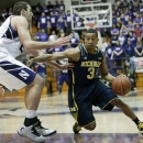 Michigan guard Trey Burke, right, drives against Northwestern center Alex Olah during the first half of an NCAA college basketball game in Evanston, Ill., Thursday, Jan. 3, 2013. (AP Photo/Nam Y. Huh)
