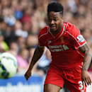 Liverpool's Raheem Sterling chases the ball during their English Premier League soccer match against Queens Park Rangers at Loftus Road, London, Sunday, Oct. 19, 2014