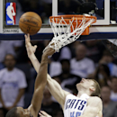 Charlotte Bobcats' Cody Zeller (40) shoots over Miami Heat's Chris Bosh (1) during the second half in Game 3 of an opening-round NBA basketball playoff series in Charlotte, N.C., Saturday, April 26, 2014. The Heat won 98-85. (AP Photo/Chuck Burton)