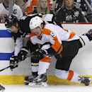 Philadelphia Flyers' Tye McGinn (15) collides with Pittsburgh Penguins' Brandon Sutter (16) in the second period of an NHL hockey game in Pittsburgh, Saturday, April 12, 2014 The Associated Press