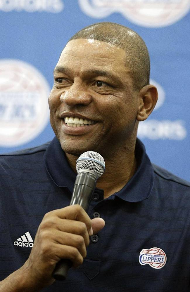 Los Angeles Clippers head coach Glenn Rivers talks to reporters during the team's NBA basketball media day on Monday, Sept. 30, 2013, in Los Angeles