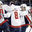 Washington Capitals defenseman Matt Niskanen (2) celebrates his goal against the Tampa Bay Lightning with teammates right wing Troy Brouwer (20) and left wing Alex Ovechkin (8), of Russia, during the first period of an NHL hockey game Tuesday, Dec. 9, 201